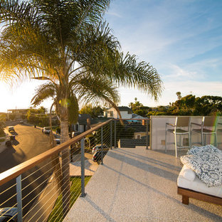 Mid-sized minimalist rooftop deck photo in San Diego with a fire pit and a pergola