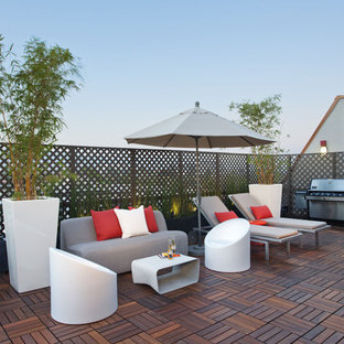Example of a large eclectic rooftop deck design in Los Angeles with no cover