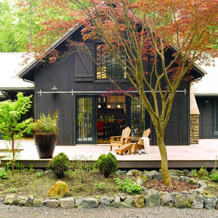 Design ideas for a medium sized rural back terrace and balcony in Seattle with a potted garden and no cover.
