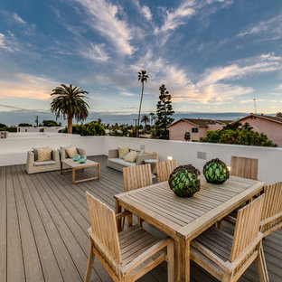 Example of a mid-sized trendy rooftop deck design in Los Angeles with no cover