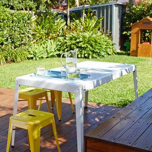 Mid-sized contemporary backyard deck in Sydney.