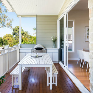 Inspiration for a contemporary deck in Brisbane with an outdoor kitchen and a roof extension.