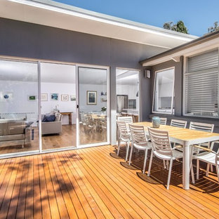 Expansive scandinavian back terrace and balcony in Canberra - Queanbeyan with a living wall and no cover.