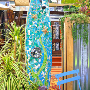 This is an example of a beach style deck in San Diego with an outdoor shower.