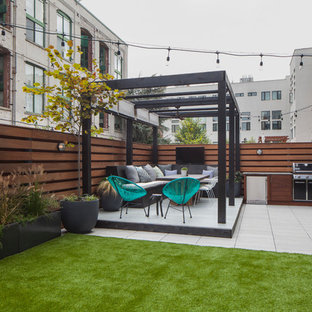 Outdoor kitchen deck - contemporary outdoor kitchen deck idea in New York with a pergola