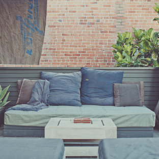 Mid-sized coastal rooftop deck photo in Los Angeles with a pergola