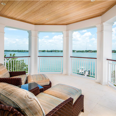 Dock - mid-sized coastal side yard dock idea in Tampa with a roof extension