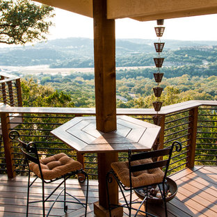 Deck - large traditional backyard deck idea in Austin with a roof extension