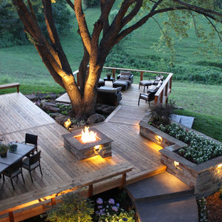 Design ideas for a large contemporary backyard deck in Kansas City with a fire feature and no cover.
