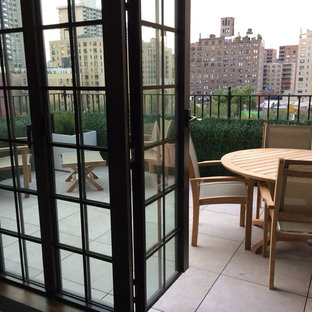 Inspiration for a small scandinavian rooftop deck remodel in New York with no cover