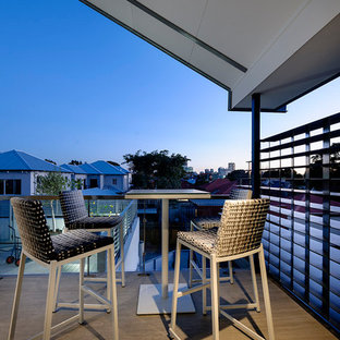 This is an example of a contemporary terrace and balcony in Perth with a roof extension.