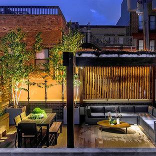 Foto di una terrazza minimal sul tetto con una pergola