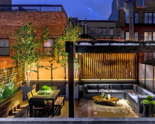 Example Of A Trendy Rooftop Deck Design In Chicago With Pergola
