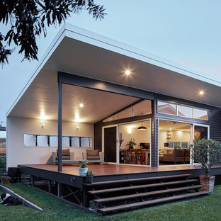 Photo of a small beach style backyard deck in Gold Coast - Tweed with a roof extension.