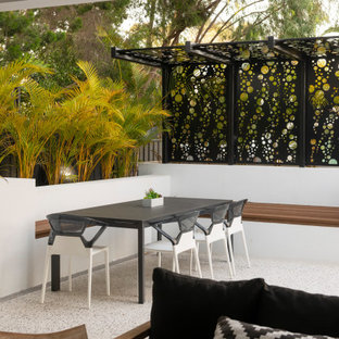 Inspiration for a mid-sized contemporary backyard deck in Perth with a container garden and a roof extension.