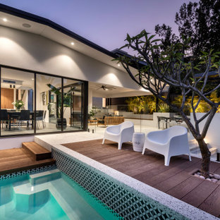 Design ideas for a midcentury deck in Perth with no cover.