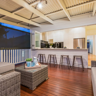 Beach style deck in Brisbane with an awning.