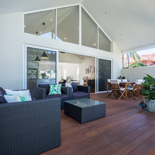 Contemporary backyard deck in Perth with a roof extension.
