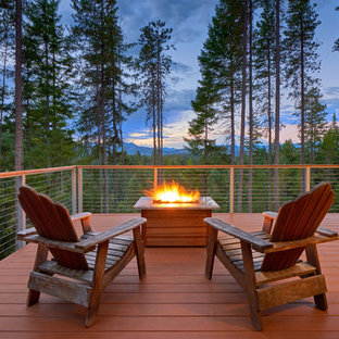 This is an example of a large contemporary backyard deck in Seattle with no cover.
