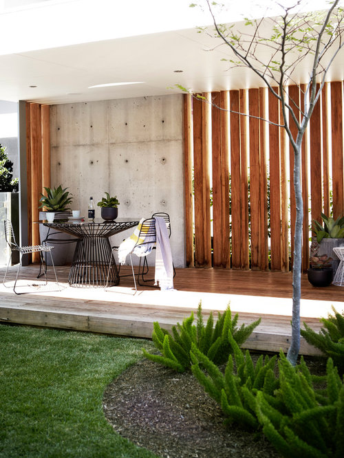 Example Of A Mid Sized Trendy Backyard Deck Design In Sydney With A Roof  Extension