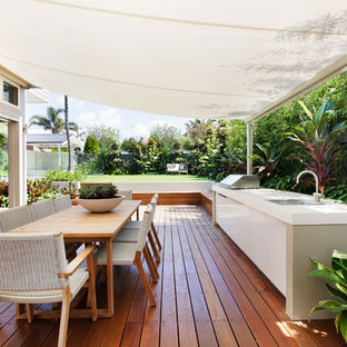Inspiration for a mid-sized transitional side yard deck in Sydney with an outdoor kitchen and an awning.