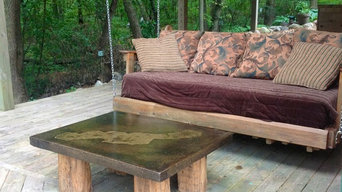 Coffee table with reclaimed beam legs with lake image