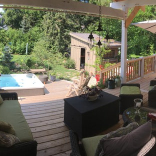 Photo of a small scandinavian back terrace and balcony in Toronto with a pergola.