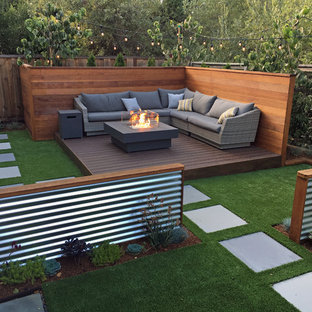 Example of a small trendy backyard deck design in San Francisco with a fire pit