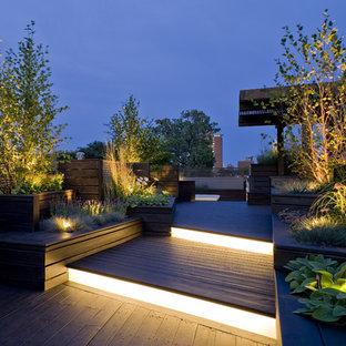 Idee per una terrazza design sul tetto con una pergola