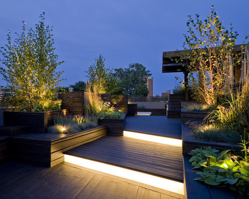 Trendy rooftop deck photo in chicago with a pergola