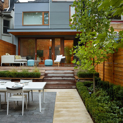 Trendy deck photo in Toronto with a roof extension