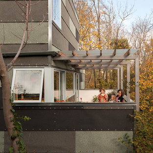 Photo of a contemporary terrace and balcony in Seattle with a pergola.