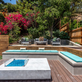 Trendy backyard deck photo in Los Angeles with a fire pit and no cover