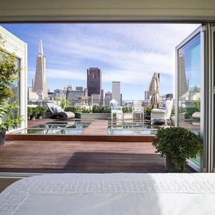 Diseño de terraza actual, de tamaño medio, sin cubierta, en azotea, con jardín de macetas