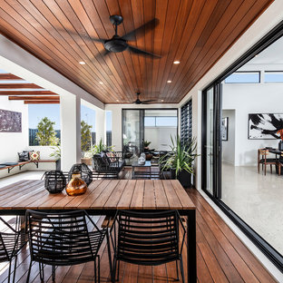 Inspiration for a contemporary deck in Brisbane with a roof extension.