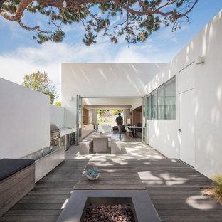 Inspiration for a contemporary backyard deck remodel in Los Angeles with a fire pit and no cover