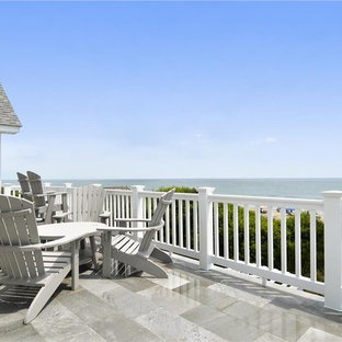 Example of a mid-sized beach style backyard deck design in Other with no cover