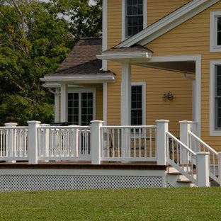 Example of a large country backyard deck design in Boston with no cover
