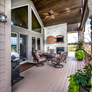 Inspiration for a mid-sized craftsman backyard deck remodel in Omaha with a roof extension