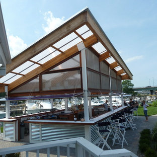 Photo of a large contemporary terrace and balcony in New York with a dock and a roof extension.