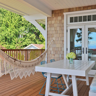 Coastal deck photo in Vancouver with a roof extension