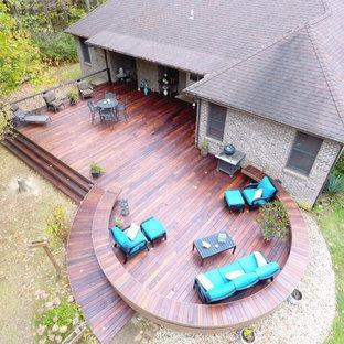Example of a large trendy backyard deck design in Cincinnati