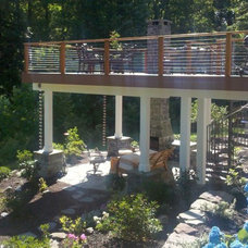 Modern Porch by The Sharper Cut, Inc. Landscapes