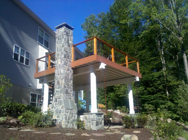 Traditional Deck by The Sharper Cut, Inc. Landscapes