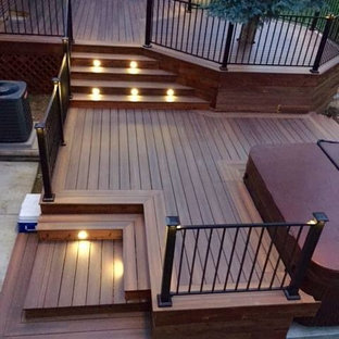 This is an example of a large arts and crafts backyard deck in Denver with no cover.