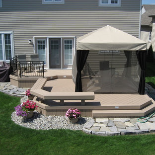 Photo of a medium sized modern back terrace and balcony in Ottawa with an awning.