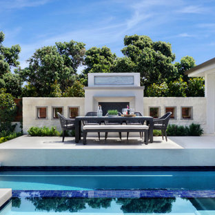 Inspiration for a mid-sized transitional courtyard deck remodel in Orange County with a fireplace and a roof extension