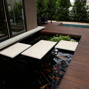 Inspiration for an asian water fountain deck remodel in Atlanta
