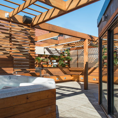 Outdoor kitchen deck - small modern rooftop outdoor kitchen deck idea in DC Metro with a pergola