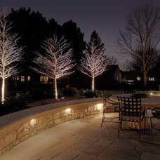 Traditional Deck by McKay Landscape Lighting